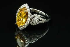 Canary diamond ring with diamond side stones set in 14kw