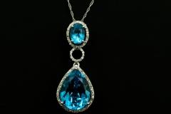 14kw blue topaz and diamond pend